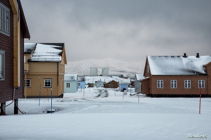Snow is seen on the Ny-Alesund research center, that was formerly a coal mining town, Oct. 19, 2015.