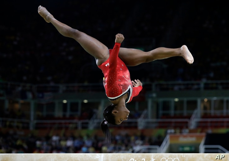 United States' Simone Biles performs on the balance beam during the artistic gymnastics women's apparatus final at the 2016 Summer Olympics in Rio de Janeiro, Brazil, Aug. 15, 2016.