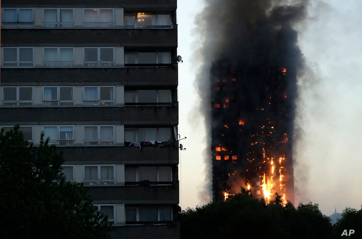 Smoke and flames rise from a building on fire in London, June 14, 2017.