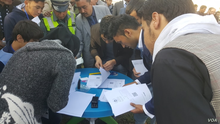 Afghanistan election officials scramble to check voter lists as minor hiccups caused delays in the start of the polling process in several polling stations across the country, Oct. 20, 2018.