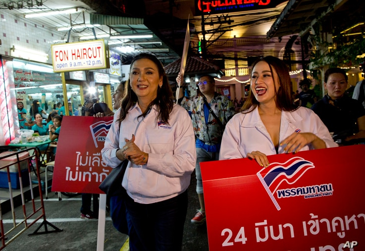 Pauline Ngaarmpring, left, a transgender person and a prime minister candidate, and Namklenginarin, right, also a candidate, both representing Mahachon Party for upcoming Thai general election, campaign in Bangkok, Feb. 13, 2019.
