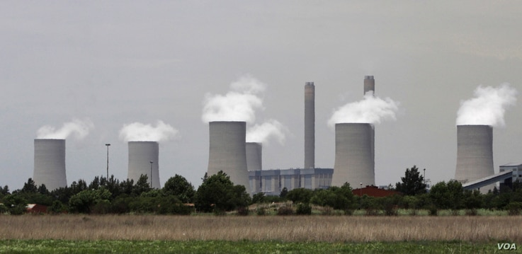 FILE - The cooling towers at Eskom's coal-powered Lethabo power station are seen near Sasolburg, South Africa.