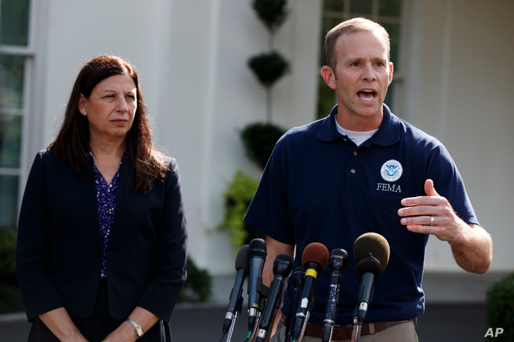 FEMA Administrator Brock Long, accompanied by acting Secretary of Homeland Security Elaine Duke, speaks to reporters about hurricane recovery efforts in Puerto Rico, outside the White House, Sept. 26, 2017, in Washington.