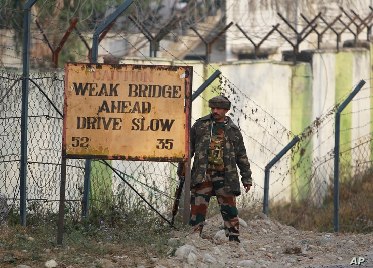 An Indian soldier takes position outside an army camp at Nagrota, in the outskirts of Jammu, Nov. 29, 2016.