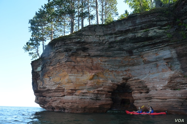 Kayakers get a unique perspective of the sea caves at Apostle Islands National Lakeshore in Wisconsin