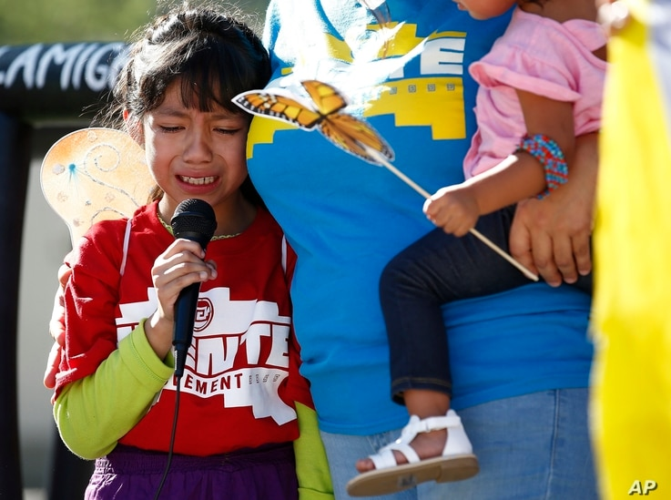 FILE - In this June 18, 2018 file photo, Akemi Vargas, 8, cries as she talks about being separated from her father during an immigration family separation protest in front of the Sandra Day O'Connor U.S. District Court building in Phoenix.