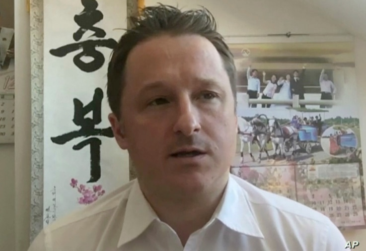 In this image made from video taken on March 2, 2017, Michael Spavor, director of Paektu Cultural Exchange, talks during a Skype interview in Yangi, China.
