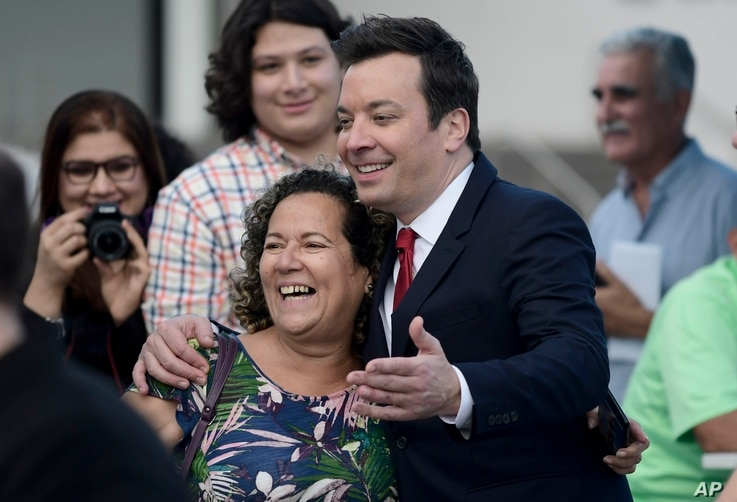 "Jimmy Fallon greets people in the entrance plaza of the Santurce Fine Arts Center moments before the premiere of the award-winning Broadway musical, ""Hamilton,"" starring its creator, New York native of Puerto Rican descent Lin-Manuel Miranda, in San ..."