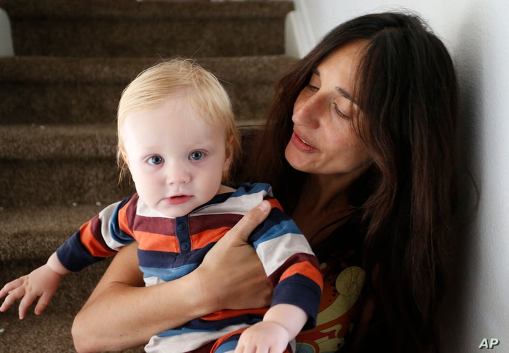 FILE - Fulvia Serra and her husband, Scott, are raising their 1-year-old son, Sebastiano, vegan. Despite criticism and innuendo from some circles, pediatricians and nutritionists agree it's perfectly healthy to feed babies a vegan diet. However, pare...