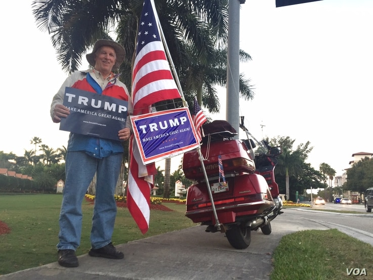 John King, 74, supports Donald Trump outside the Florida site where Monday's event was canceled ahead of the primary, March 14, 2016. (C. Mendoza/VOA)