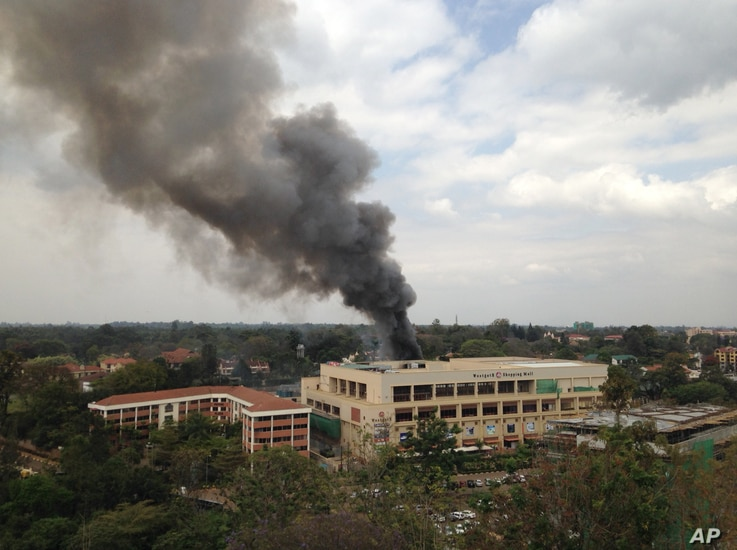 FILE - Heavy smoke rises from the Westgate Mall in Nairobi, Kenya, after multiple large blasts rocked the facility during an assault by security forces, Sept. 23, 2013, in response to a terrorist attack.
