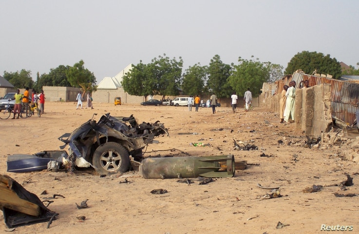 FILE - Damage is seen following an attack by Boko Haram militants in the northeast city of Maiduguri, Nigeria, April 27, 2018. In Senegal, 29 suspects are awaiting a ruling on terrorism-related charges. Most of the suspects are believed to have fough...
