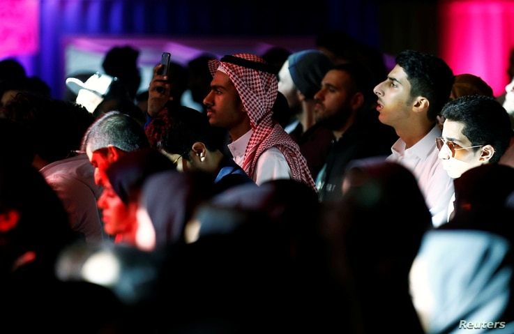 People attend the jazz festival in Riyadh, Saudi Arabia, Feb. 23, 2018. The area in front of the stage was divided into two sections — one for men and one for women — but people mixed in family seating areas on the side and in the back.
