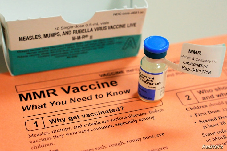 FILE - A vial of measles, mumps and rubella vaccine and an information sheet is seen at Boston Children's Hospital in Boston, Massachusetts, Feb. 26, 2015.