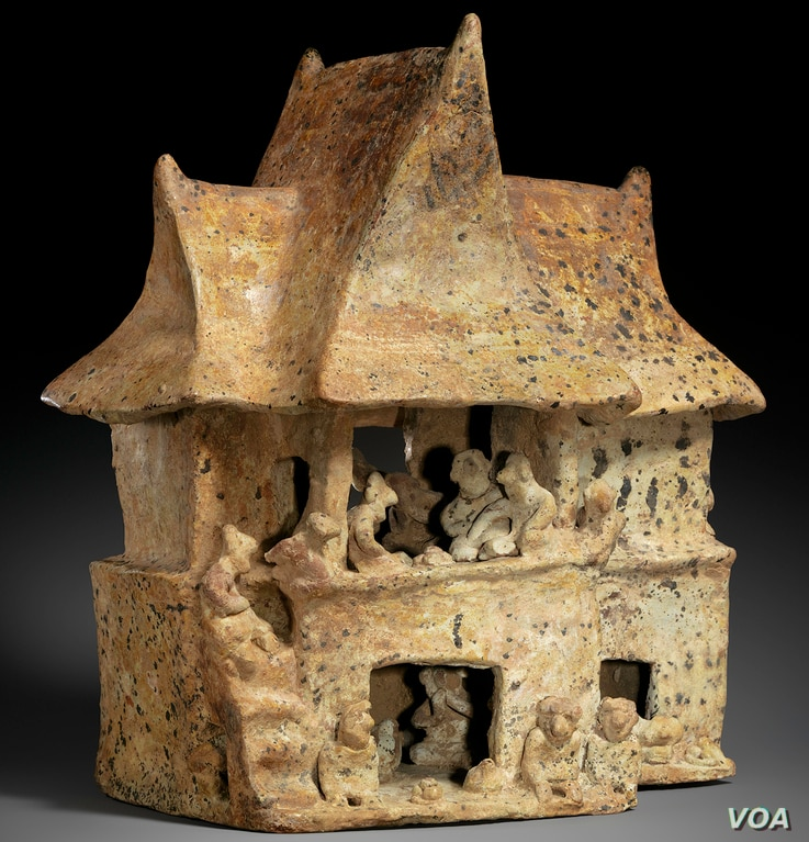 This two-story Nayarit house (100 B.C to A.D. 200) depicts a great feast. On the upper level, 16 figures, including pairs of men and women with their arms wrapped around one another, gather around vessels filled with food and beverages.(Credit: Metro...