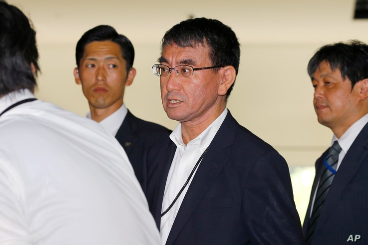 Japan's new Foreign Minister Taro Kono, center, leaves the prime minister's official residence in Tokyo, Aug. 3, 2017.