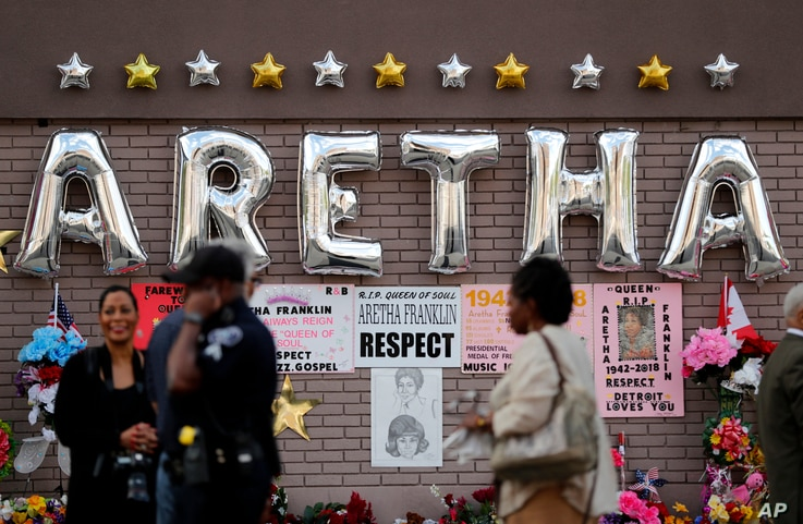 People gather outside New Bethel Baptist Church before a viewing for Aretha Franklin, Aug. 30, 2018, in Detroit.