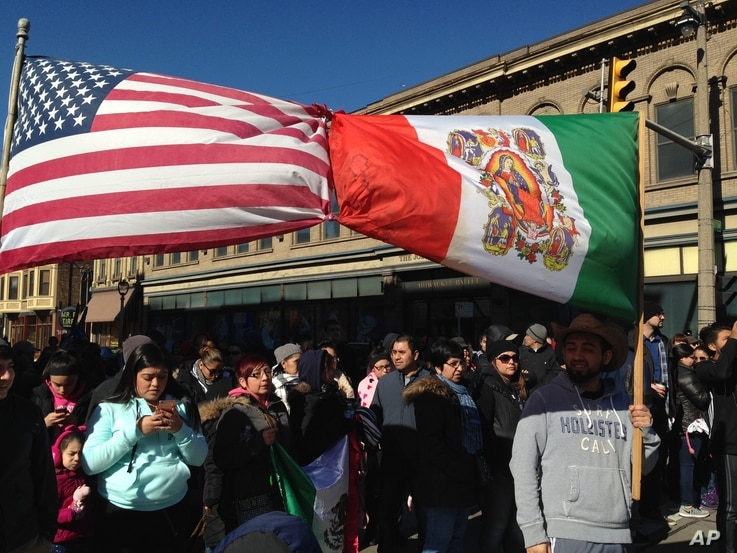 Thousands of Wisconsin activists gather in Milwaukee's predominantly Hispanic South Side to protest the county sheriff's plans to crack down on illegal immigration, Feb. 13, 2017.