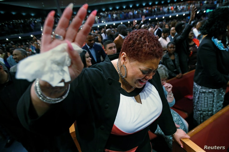 Jennifer Whitson cries during a service at the Potter's House church during Sunday service following the multiple police shootings in Dallas, Texas, U.S., July 10, 2016.
