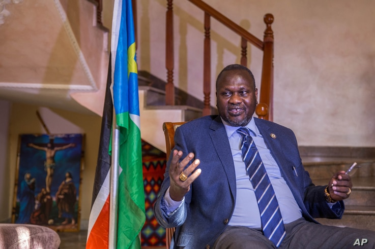FILE - South Sudan rebel leader Riek Machar talks to reporters at his private residence in Ethiopian capital, Addis Ababa, Feb. 13, 2016. He says he is ready to return to Juba in March to take up his position as first vice president.