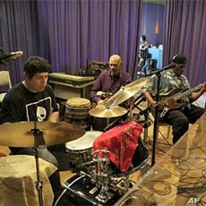 Students have recorded CDs with well-known bands like Taj Mahal
