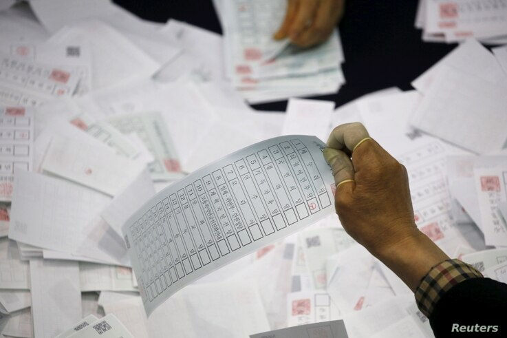National Election Commission officials count ballots at a ballot count location in Seoul, South Korea, April 13, 2016.