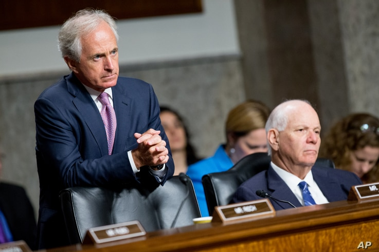 FILE - Chairman Sen. Bob Corker, left, and Ranking Member Sen. Ben Cardin, right, are seen hearing testimony during a Senate Foreign Relations Committee hearing on Capitol Hill, in Washington, July 23, 2015.