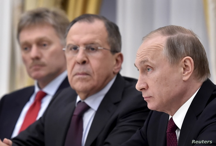Russian President Vladimir Putin, Foreign Minister Sergei Lavrov and Kremlin spokesman Dmitry Peskov (R-L) attend a meeting with Sheikh Mohammed bin Zayed al-Nahyan (not pictured), Crown Prince of Abu Dhabi and UAE's deputy commander-in-chief of the