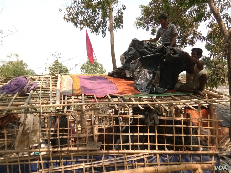 Ahead of the monsoon, when heavy rains and cyclonic storms are likely to hit the region, some Rohingyas are busy doing some reinforcing work at a shack in Kutupalong refugee camp, Cox's Bazar, Bangladesh.
