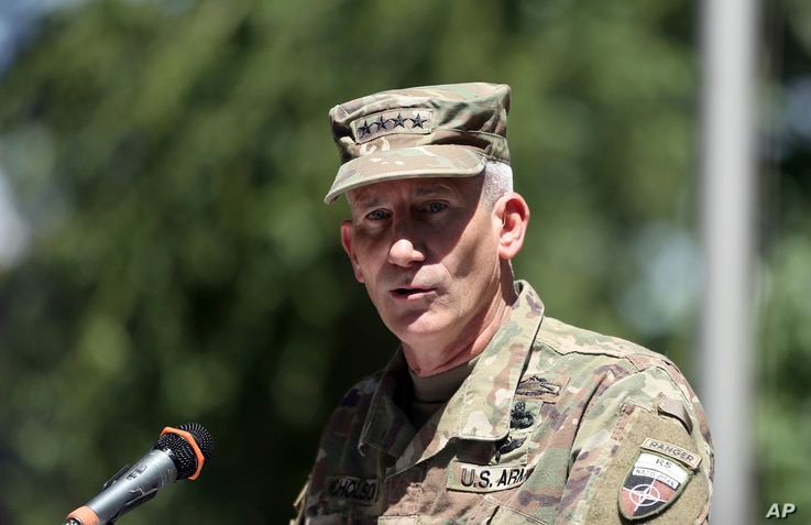 """Commander of the Resolute Support mission and U.S. Forces in Afghanistan Army Gen. John W. Nicholson speaks during an opening ceremony of """"Invictus Games"""" at the Resolute Support Headquarters, in Kabul, Afghanistan, May 13 , 2017."""