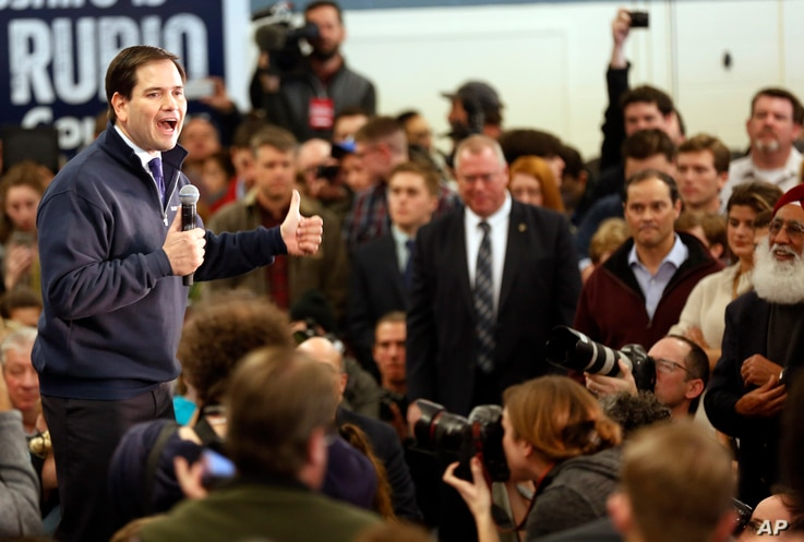 Republican presidential candidate Sen. Marco Rubio, R-Fla., works to charge up a crowd during a campaign stop in a high school cafeteria, Sunday, Feb. 7, 2016, in Londonderry, N.H.