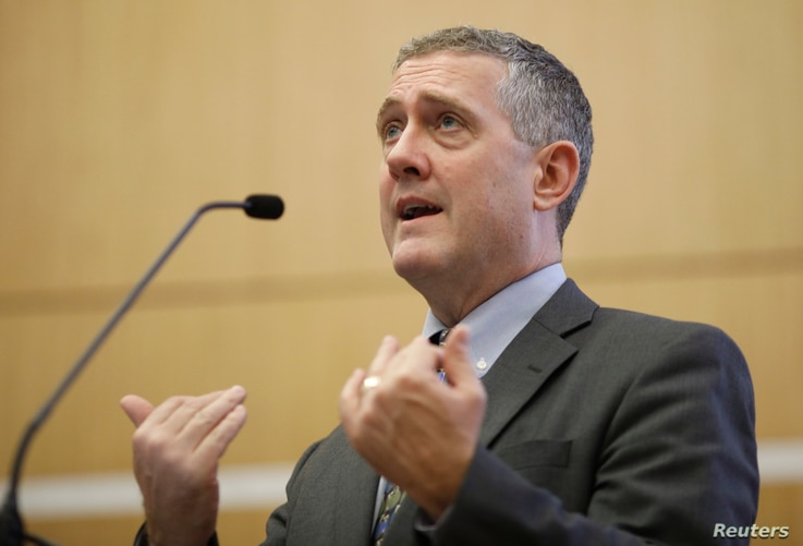 FILE - St. Louis Federal Reserve Bank President James Bullard speaks at a public lecture in Singapore, Oct. 8, 2018.