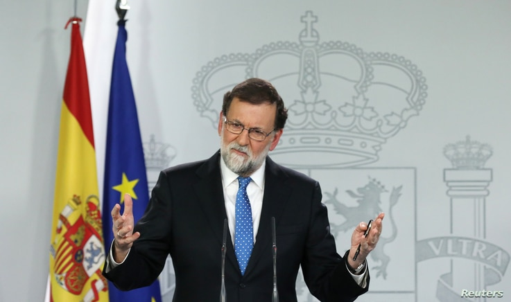 Spain's Prime Minister Mariano Rajoy attends a press conference at the Moncloa Palace in Madrid, Dec. 22, 2017.