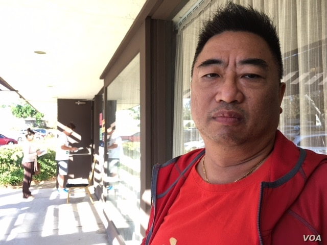 """Raymond Lee, 52, is a reluctant Hillary Clinton supporter and considers Donald Trump a """"demagogue,"""" but worries that this election has made the United States a laughing stock. (M. O'Sullivan/VOA)"""