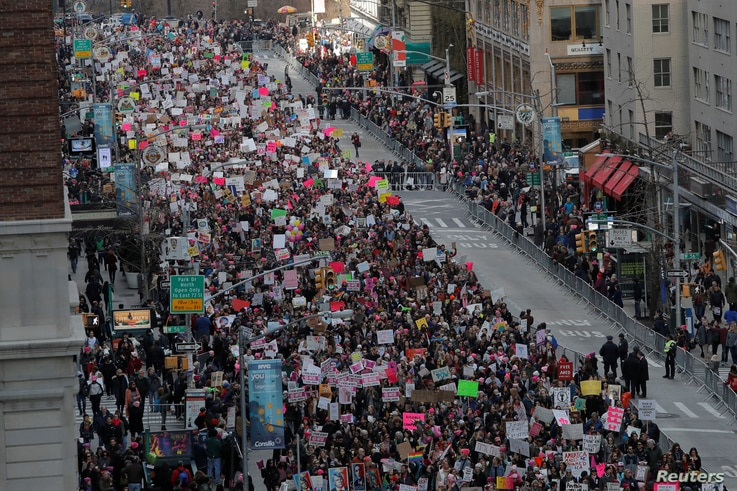 People walk down Sixth Avenue as they participate in the Women's March in Manhattan, New York City, Jan. 20, 2018.