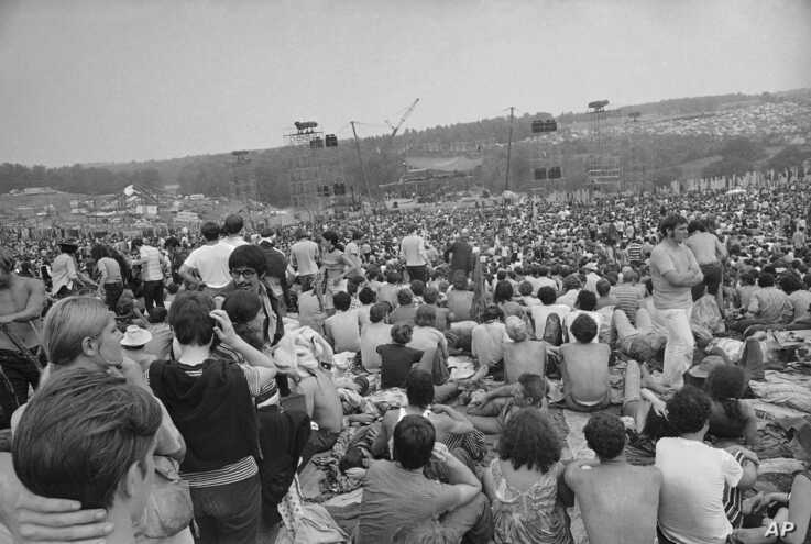 FILE - This is a general view of the crowd at the Woodstock Music and Arts Festival, Aug. 14, 1969.