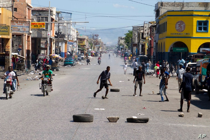 Youth play soccer in the middle of a normally busy downtown street, left empty by a transportation strike in Port-au-Prince, Haiti,  Sept. 18, 2017.