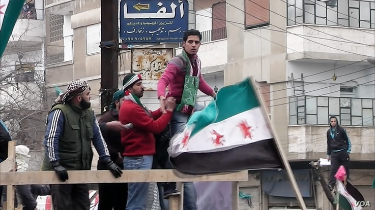 """A scene from """"Return To Homs"""" (Courtesy Proaction Film-Directed by Talal Derki-Syria and Germany)"""