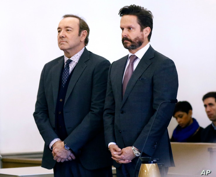 Actor Kevin Spacey stands with his attorney Alan Jackson, right, in district court during arraignment on a charge of indecent assault and battery, Jan. 7, 2019, in Nantucket, Massachusetts.