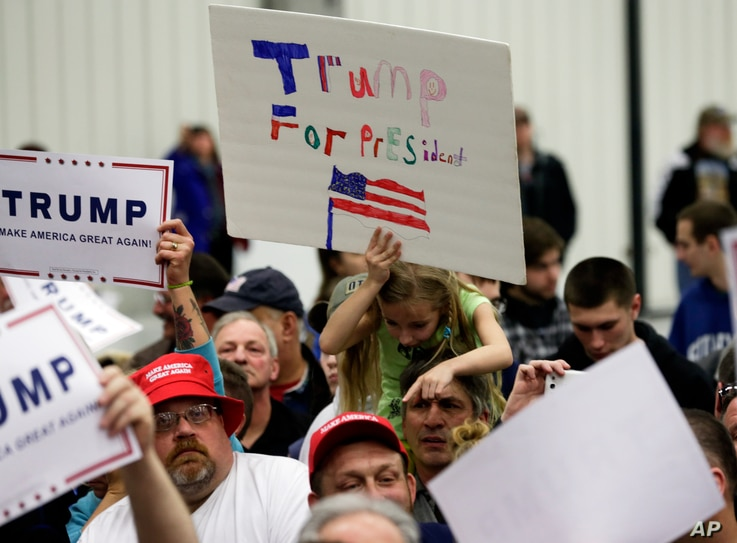 Supporters of Republican presidential candidate Donald Trump try to get autographs after a rally at Griffiss International Airport in Rome, New York, April 12, 2016.