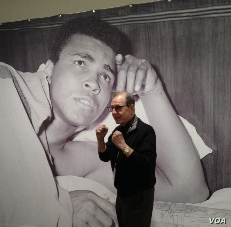 George Kalinsky, who photographed Ali for 50 years, standing In front of his photo. (New York Historical Society)