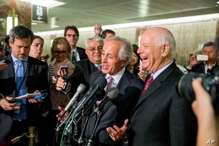 FILE -Senate Foreign Relations Committee Chairman Sen. Bob Corker, R-Tenn., (C) and the committee's ranking member Sen. Ben Cardin, D-Md. speak to reporters on Capitol Hill in Washington, April 14, 2015, as the Senate muscled its way into President B...