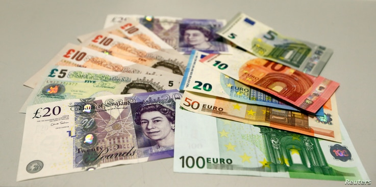 British pounds and Euro banknotes are pictured in a bank at the main train station in Munich, Germany, June 24, 2016 after Britain voted to leave the European Union in the EU BREXIT referendum.