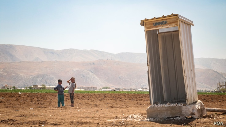 A UNHCR toilet stands solitary in what used to be a refugee camp. The recent eviction notice has affected between 8000 and 12000 refugees in Lebanon's Bekaa Valley.