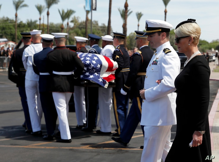 Cindy McCain walks with her son Jack as the honor guard carries the casket after a memorial service for Sen. John McCain, R-Ariz. at the North Phoenix Baptist Church on Aug. 30, 2018, in Phoenix.