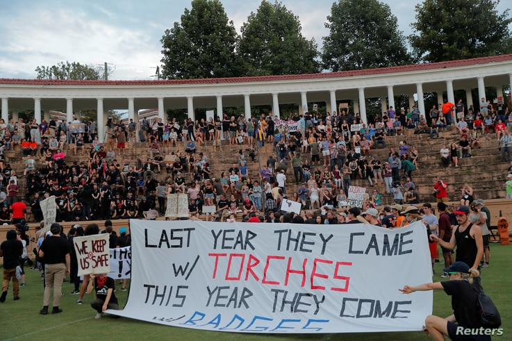 """Protesters gather at Lambeth Field at the University of Virginia ahead of the one year anniversary of the 2017 Charlottesville """"Unite the Right"""" protests, in Charlottesville, Va., Aug. 11, 2018. The heavy security presence this year angered some stud..."""