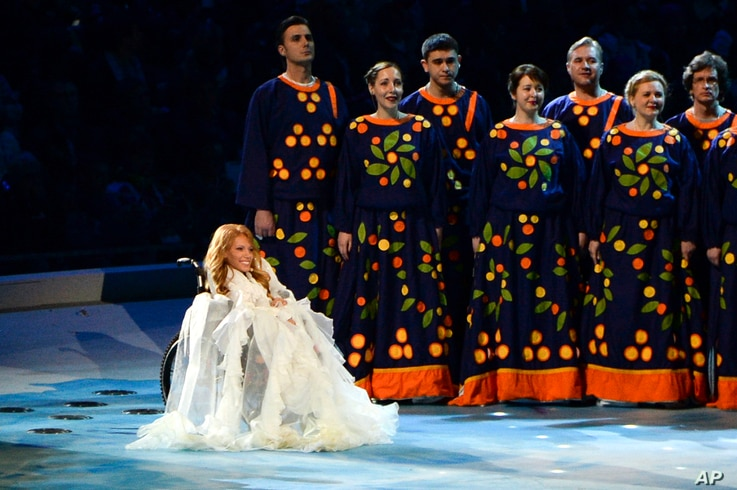 FILE - Yulia Samoylova appears on stage during the opening ceremony of the 2014 Paralympic Games in Sochi, Russia, March 7, 2014.