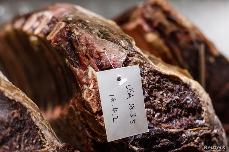 FILE - Beef imported from the U.S. is seen at Wolfgang's, a high-end steak house in East Beijing's Sanlitun district, China, April 6, 2018. China says meat products are among the U.S. good to be affected July 6 by tariffs.