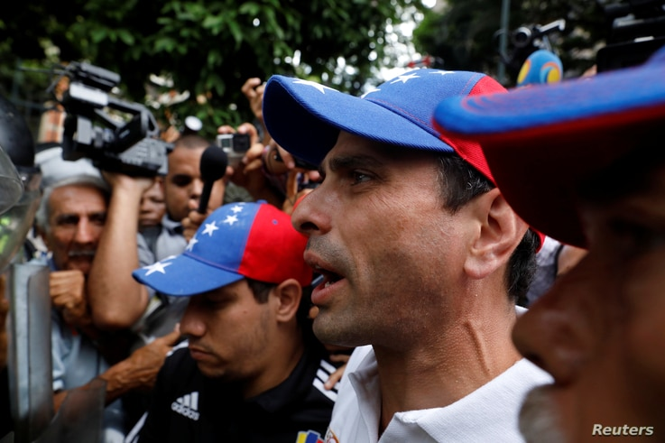 Venezuela opposition leader and Governor of Miranda state Henrique Capriles confronts security forces while rallying against President Nicolas Maduro in Caracas, Venezuela, May 12, 2017.