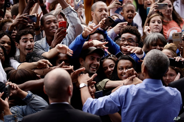 FILE - President Barack Obama meets with members of the audience as he campaigns in support of Pennsylvania candidates in Philadelphia, Sept. 21, 2018. Two months out from Election Day, Democrats are increasingly confident about their prospects to pi...